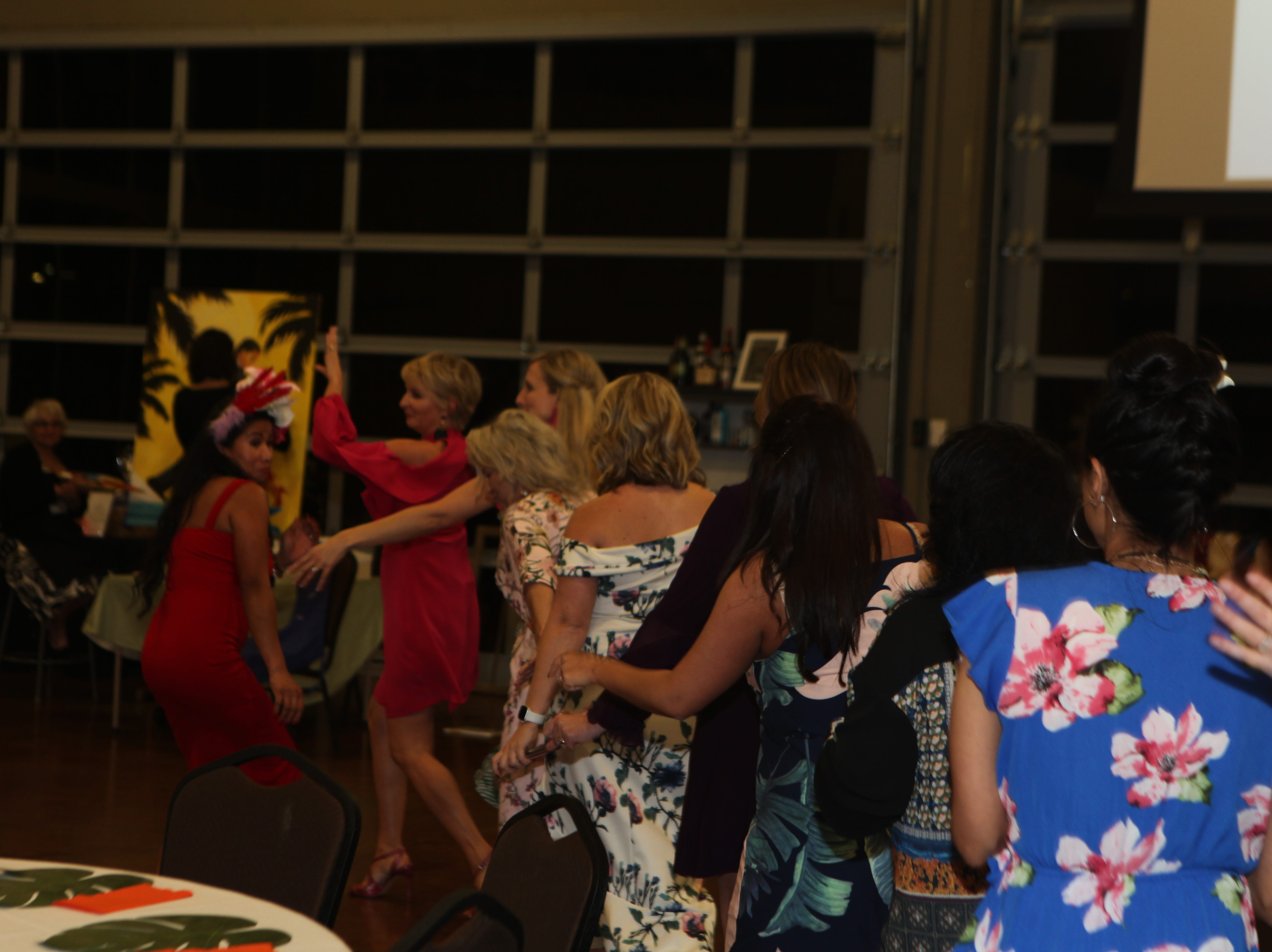 A spontaneous conga line at the Fort Campbell Spouses Club Very Important Charity Event on March 9, 2019.