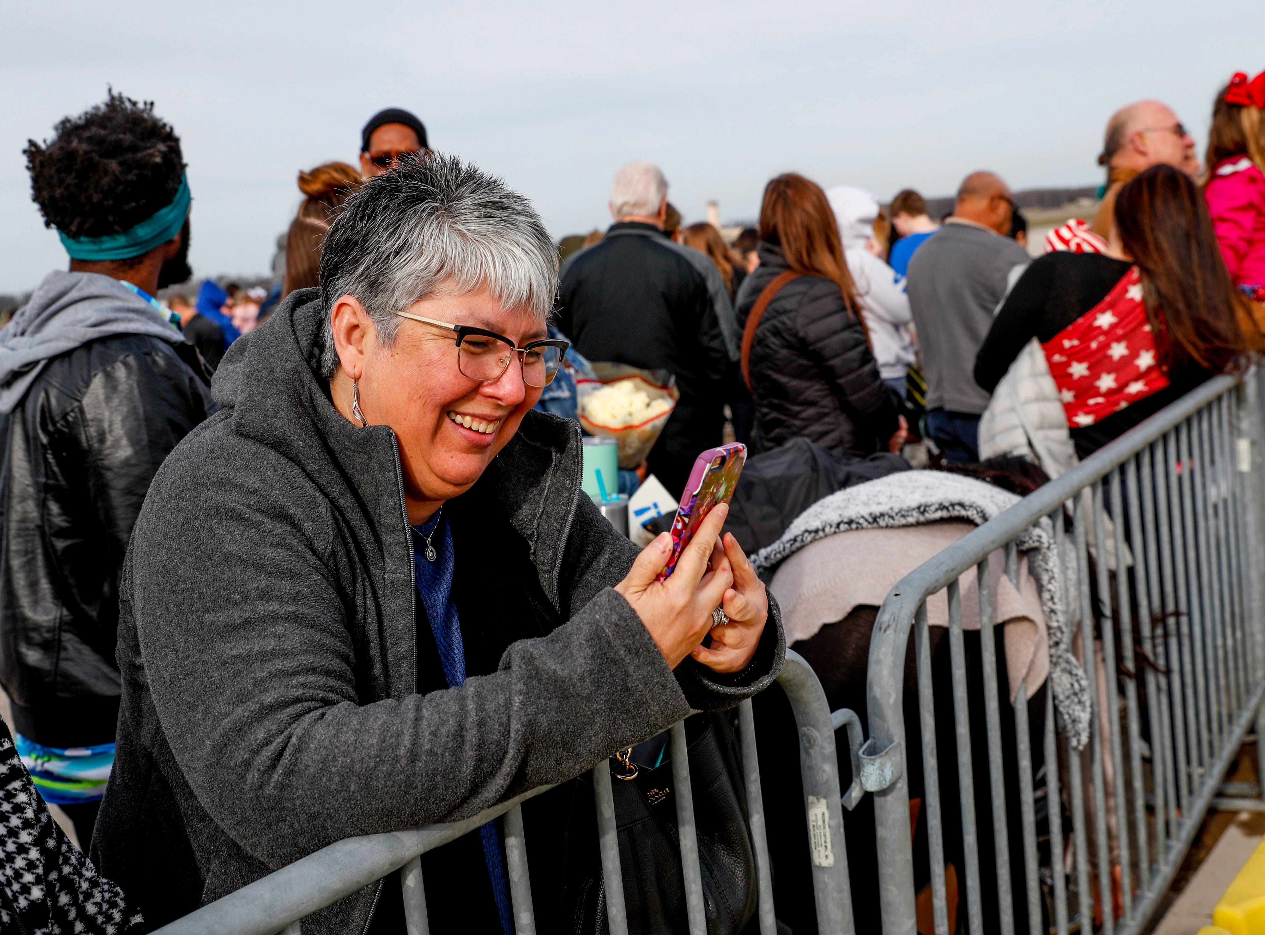 Barbarah Martinez video chats with her son's girlfriend to stream the return of her son during the return of soldiers from the 101st Combat Aviation Brigade of 101st Airborne Division (Air Assault) at Campbell Army Air Field in Fort Campbell, KY., on Sunday, March 10, 2019.
