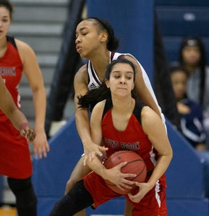 Joscelyn Williams, University, reaches over Evelyn Nunez, Bound Brook, to try and steal the ball.  Bound Brook Girls Basketball vs University  in Girls Group I Final in Toms River on March 10, 2019.
