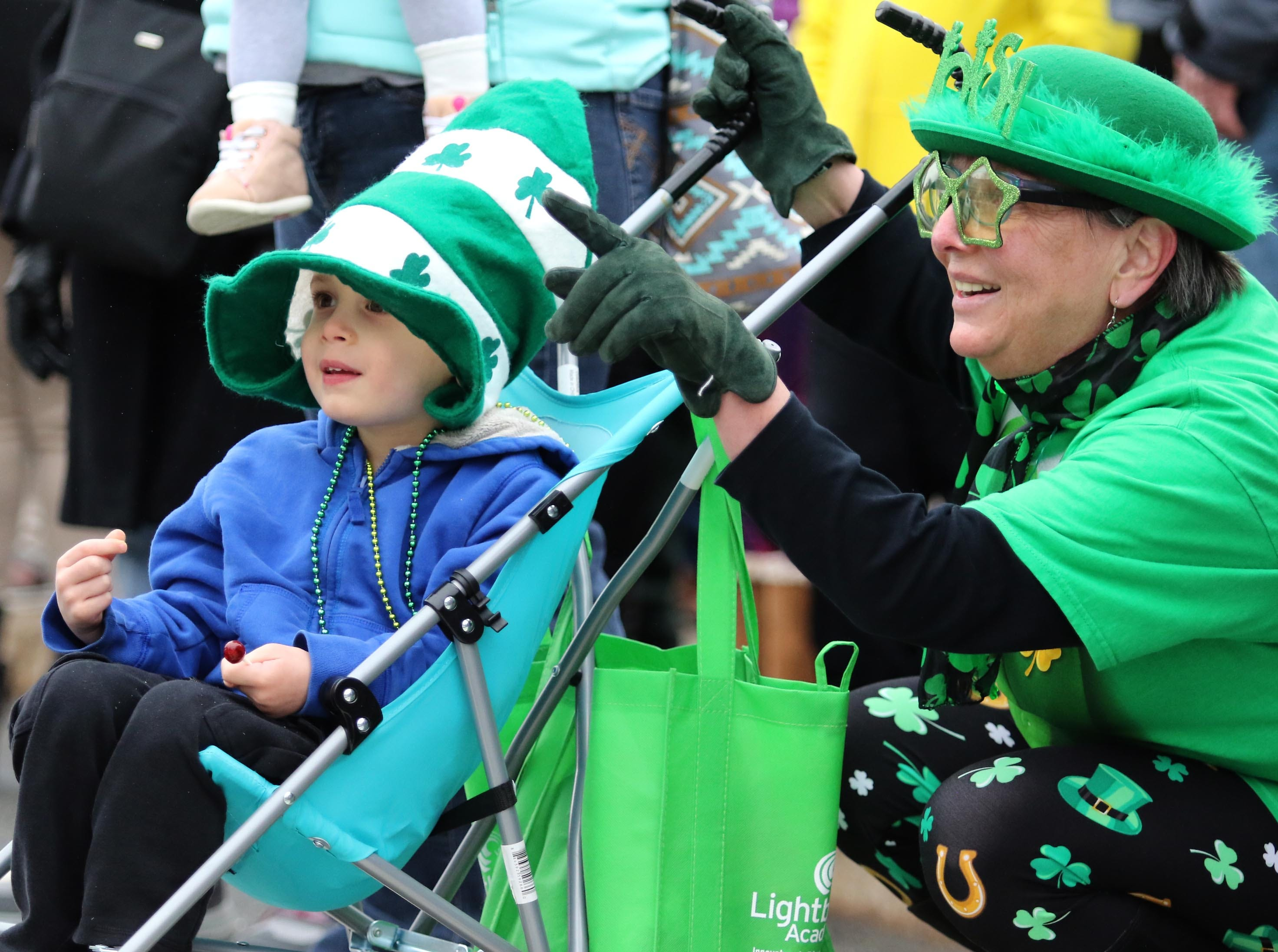 Jackson Condoluci, 3, of Manville, and his grandmother Doreen Maso, of Green Brook, enjoy the sights and sounds of the 28th Somerville St. Patrick's Parade along Main Street on Sunday.