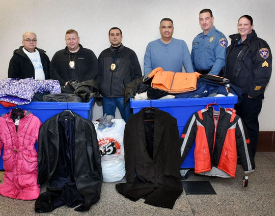 Union County Sheriff Peter Corvelli joined Sheriff's Sgt. Tara Halpin, Det. Luis Alfaro and OfficerKeith Rhyner, on behalf of the Sheriff' Office Tree of Hope charity, in donating coats to Rev. Orlando Sanchez and Roberto Semiday of the Iglesia de Dios Pentecostal M.I Church of Carteret. Union County employees donated more than 100 coats to the Tree of Hope to be distributed to charities helping those in need in Union County.
