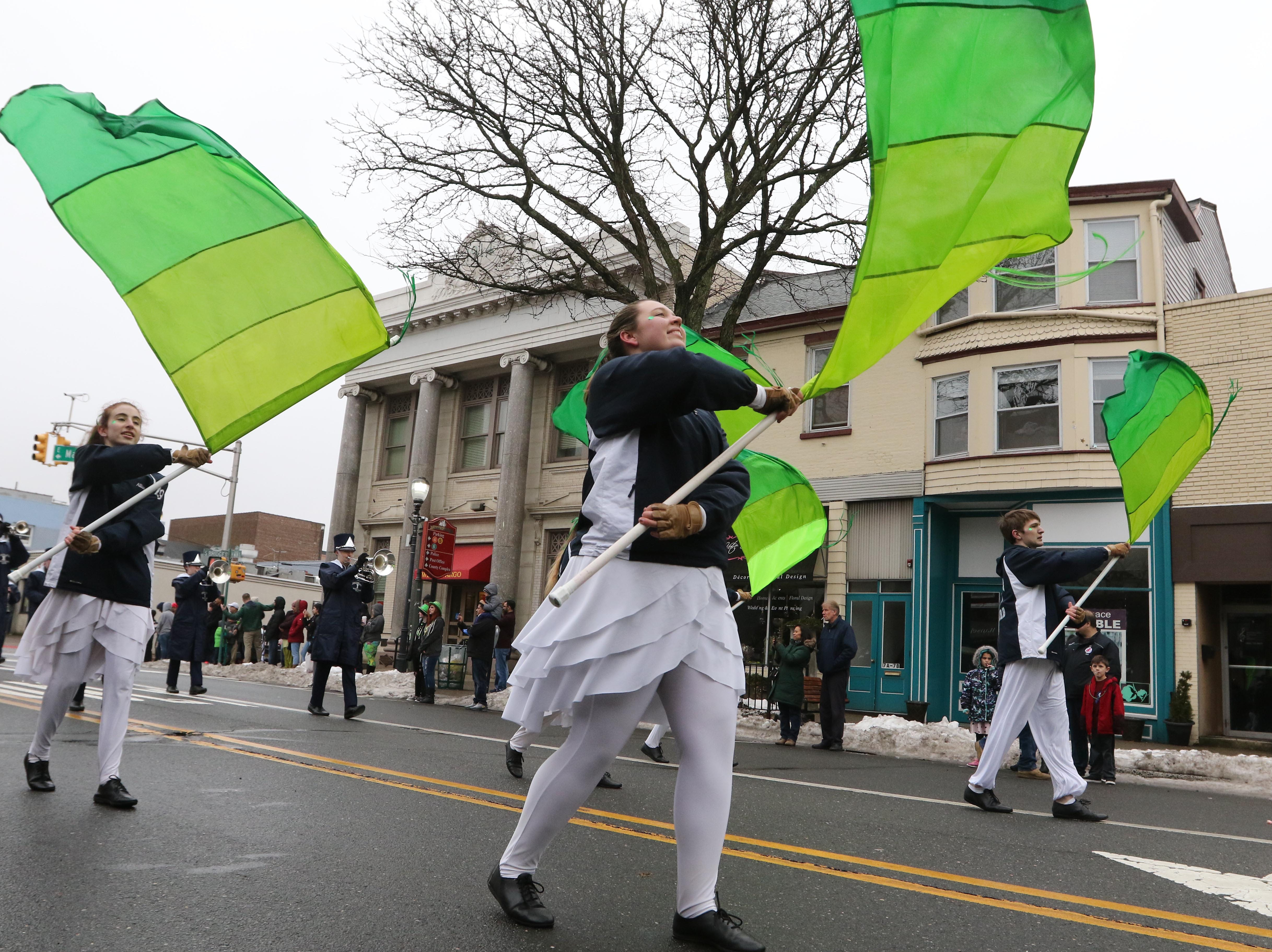 Members of the Immaculata High School marching band take part in the 28th Somerville St. Patrick's Parade along Main Street on Sunday.