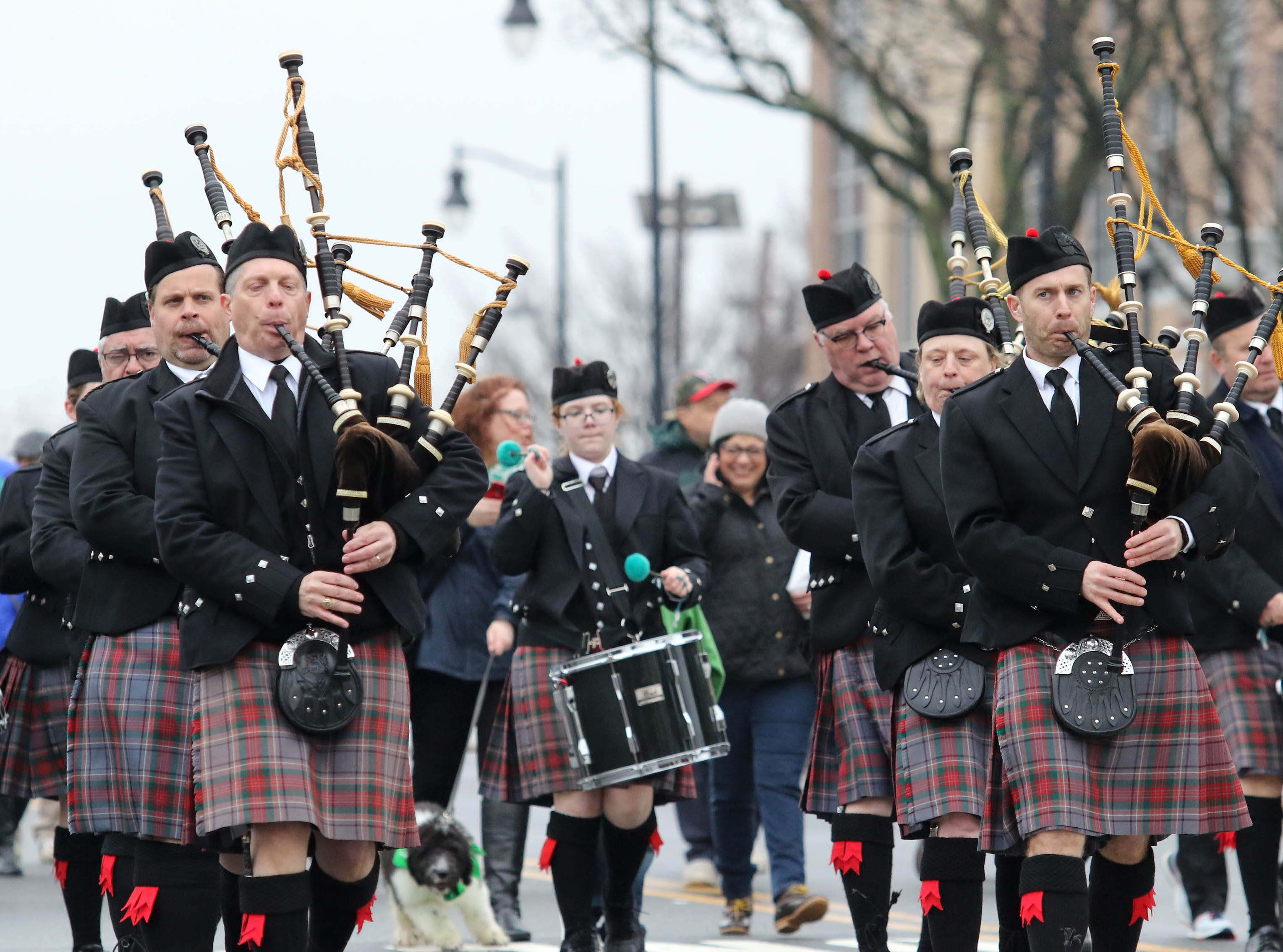 Members of the Saint Ann's of Hampton Pipes and Drums take part in the 28th Somerville St. Patrick's Parade along Main Street on Sunday.