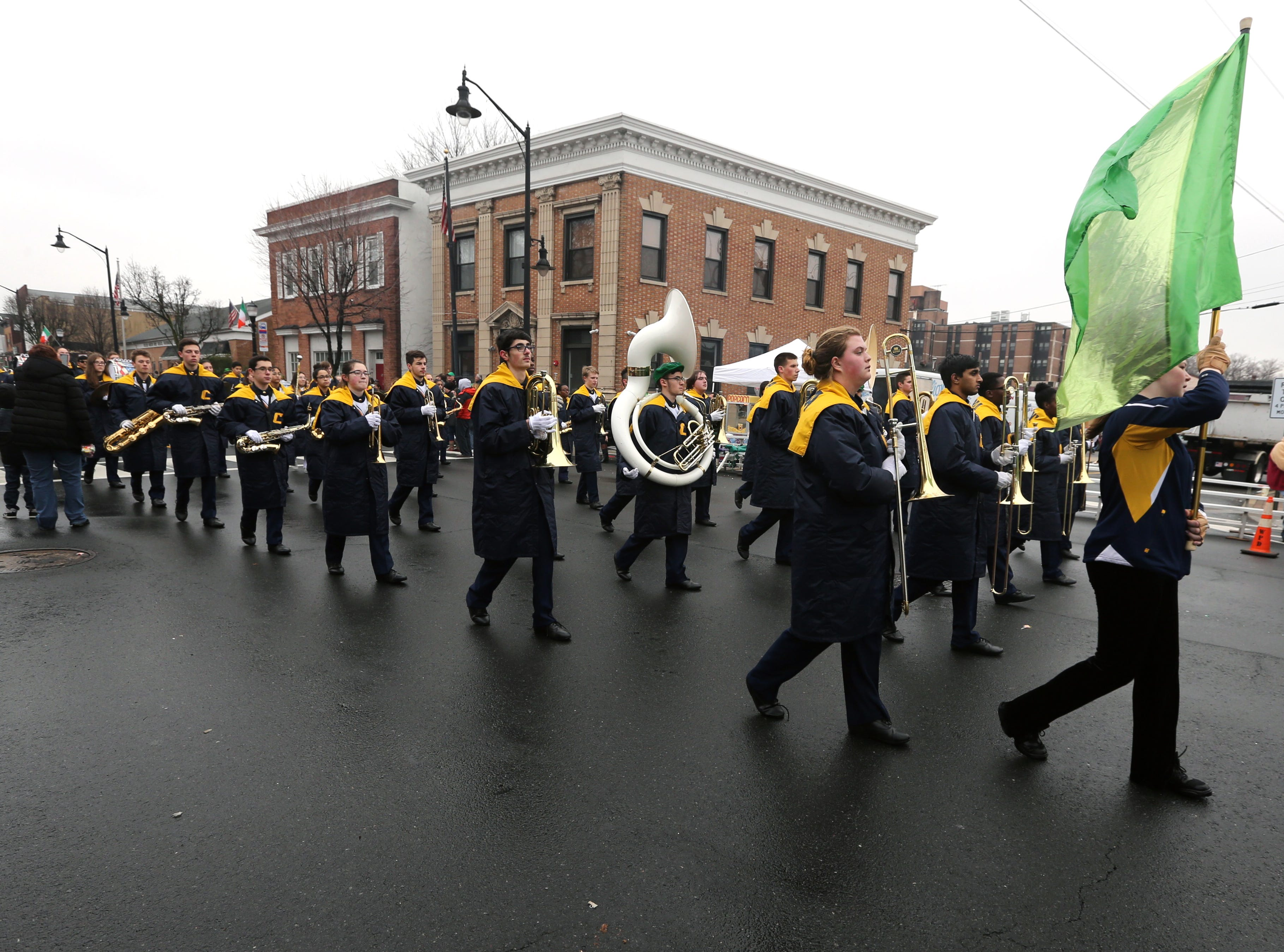 Colonia High School marching band performs in the Woodbridge St. Patrick's Day Parade along Main Street on Sunday.