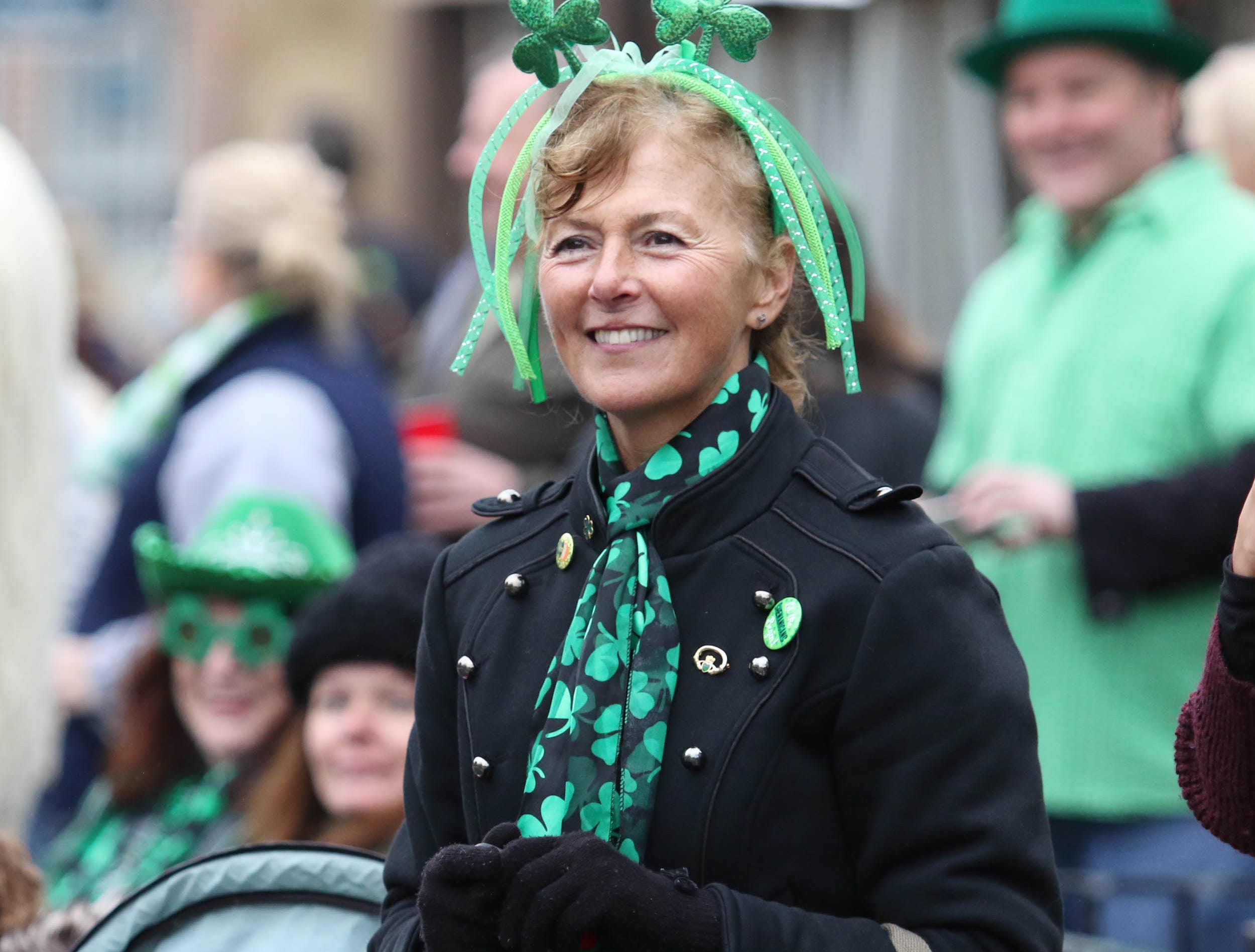 Donna O'Shea of Bridgewater enjoys the sights and sounds of the 28th Somerville St. Patrick's Parade along Main Street on Sunday.