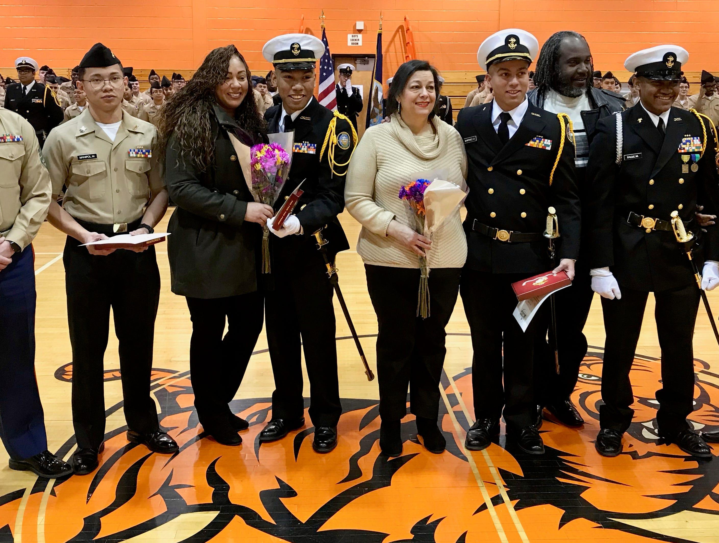 Linden High School NJROTC Marine recruits with recruiter Staff Sgt. Harry Gitlitz, left, and their parents.