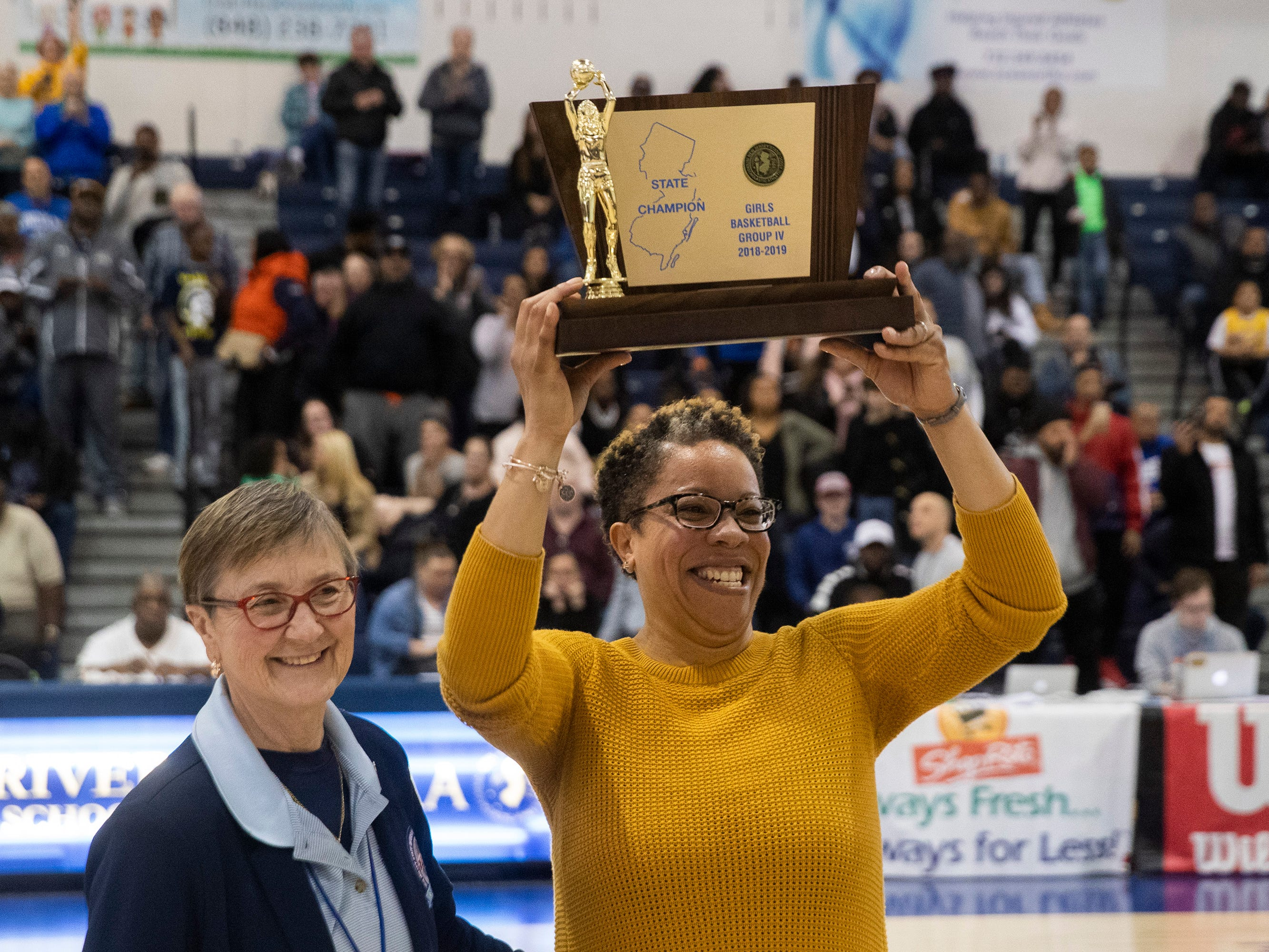 Franklin Coah Audrey Taylor holds up her team's Group IV trophy. Franklin Girls Basketball vs Lenape in Girls Group IV Final in Toms River on March 10, 2019.