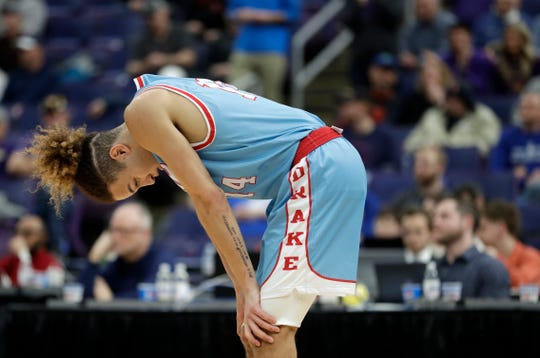 Drake's Noah Thomas pauses late during the second half of an NCAA college basketball game against Northern Iowa in the semifinal round of the Missouri Valley Conference tournament, Saturday, March 9, 2019, in St. Louis. Northern Iowa won 60-58.