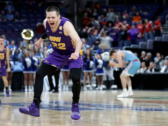 Northern Iowa's Wyatt Lohaus celebrates as the final horn sounds at the end of an NCAA college basketball game against Drake in the semifinal round of the Missouri Valley Conference tournament, Saturday, March 9, 2019, in St. Louis. Lohaus hit a basket with seconds left to give Northern Iowa a 60-58 victory.