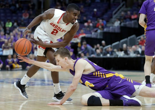 Northern Iowa's Luke McDonnell, bottom, knocks the ball away from Bradley's Luqman Lundy during the second half of the Missouri Valley Conference Tournament final, Sunday in St. Louis.