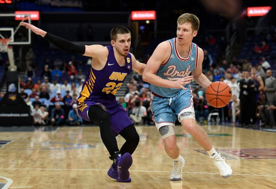 Mar 9, 2019; St. Louis, MO, United States; Northern Iowa Panthers guard Wyatt Lohaus (22) defends against Drake Bulldogs guard Brady Ellingson (22) during the second half in the Missouri Valley Conference Tournament at Enterprise Center.