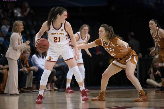 Iowa State Cyclones guard Bridget Carleton (21) dribbles against Texas Longhorns guard Audrey Warren (31) during the second quarter in the women's Big 12 Conference Tournament at Chesapeake Energy Arena.