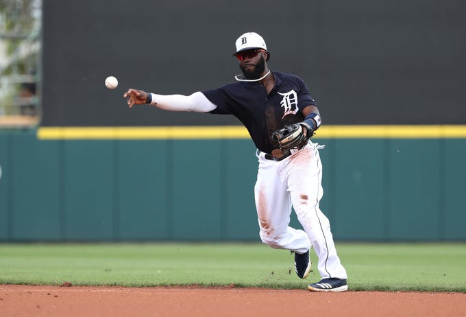 Tigers second baseman Josh Harrison throws the ball to first base for an out during the second inning in the exhibition tie against the New York Yankees on Sunday, March 10, 2019, at Joker Marchant Stadium.