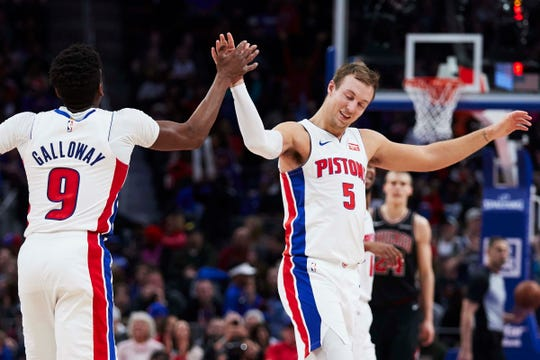Pistons guard Langston Galloway receives congratulations from guard Luke Kennard after he makes a 3-point basket in the second half of the Pistons' 131-108 win on Sunday, March 10, 2019, at Little Caesars Arena.