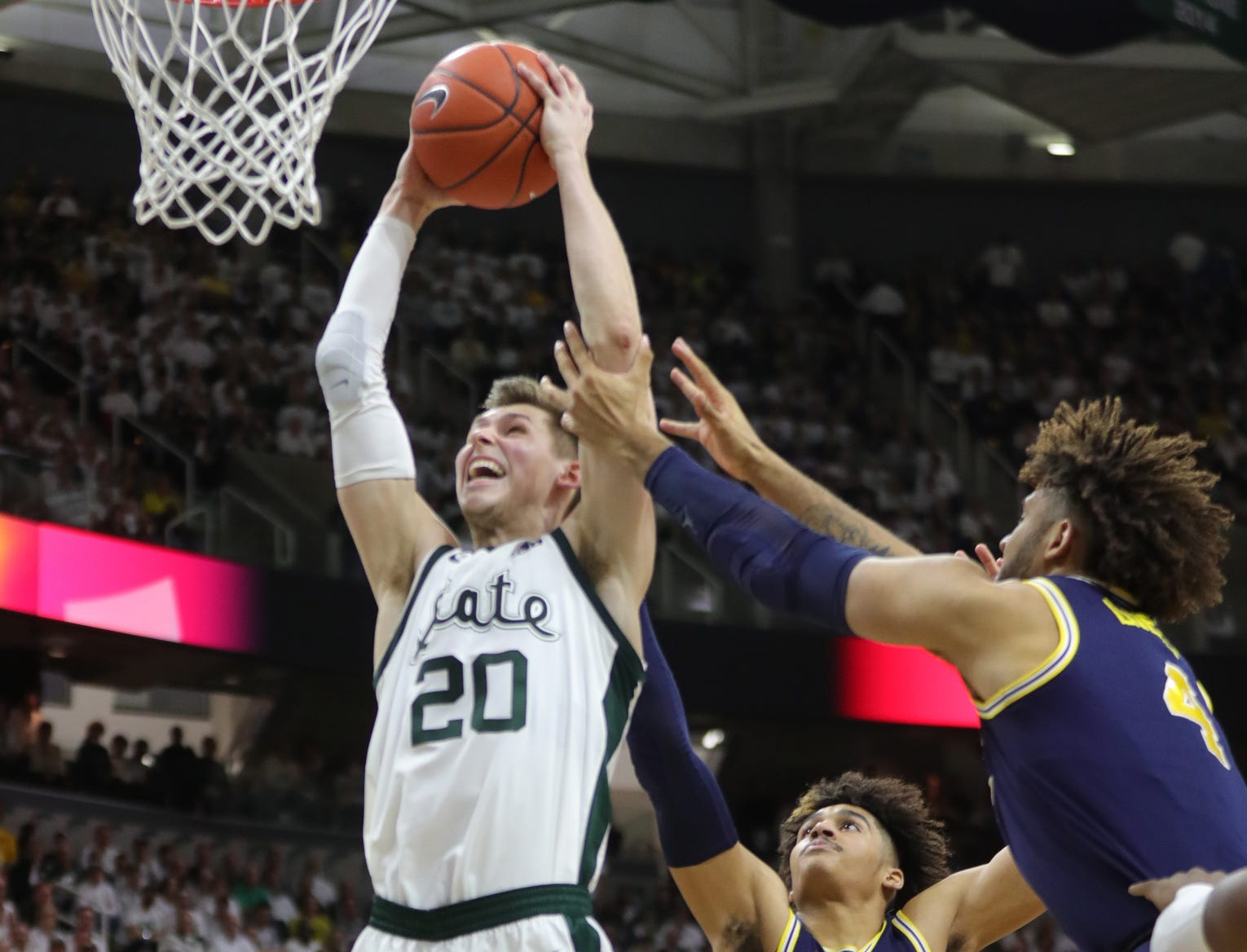 Michigan State's Matt McQuaid scores against Michigan during the second half March 9 at the Breslin Center.