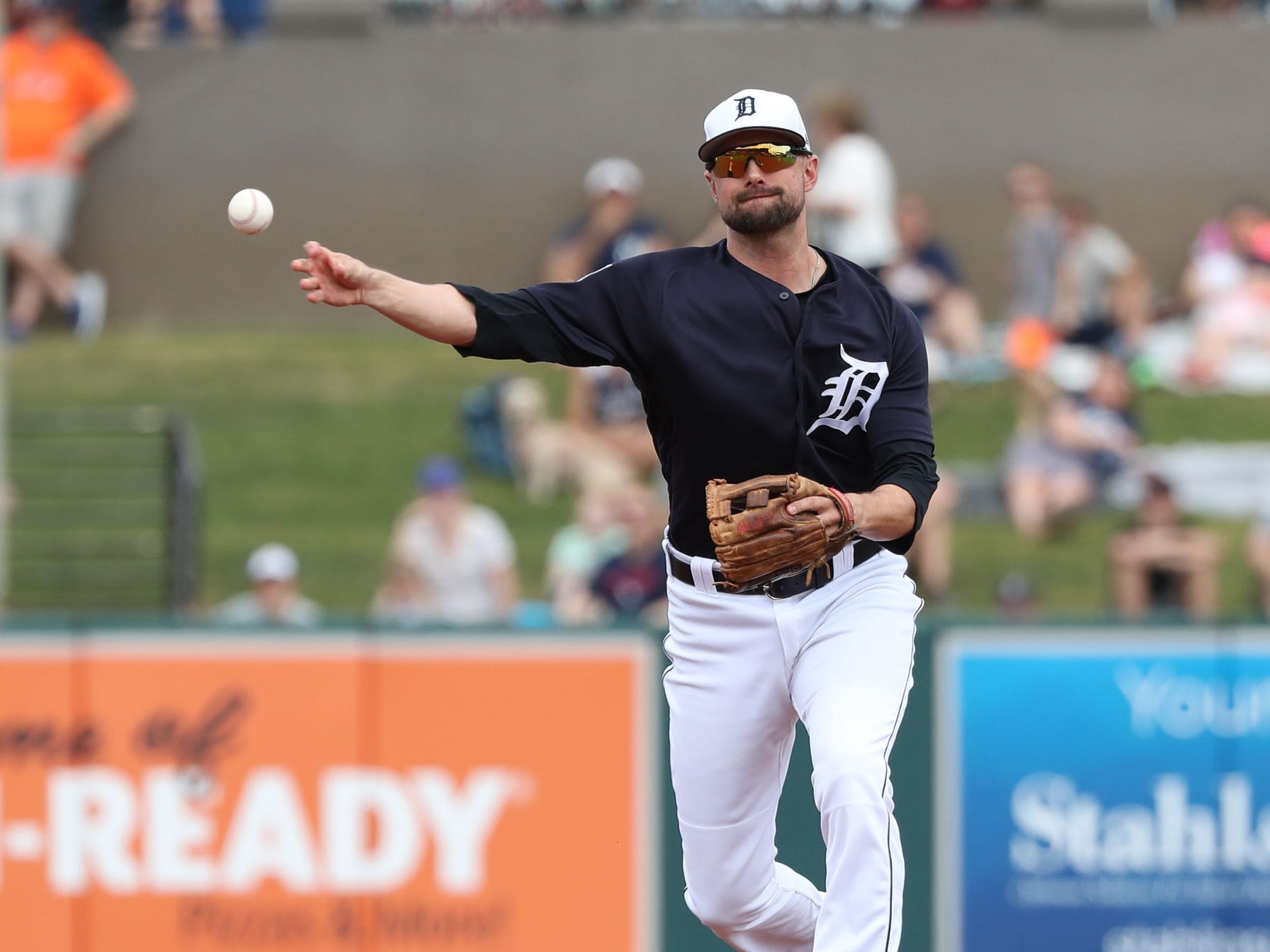 Tigers shortstop Jordy Mercer throws the ball to first base for an out during the first inning against the New York Yankees on Sunday, March 10, 2019, at Joker Marchant Stadium.