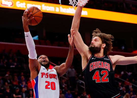 Pistons guard Wayne Ellington shoots on Bulls center Robin Lopez in the first half on Sunday, March 10, 2019, at Little Caesars Arena.