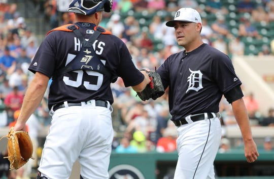 Tigers pitcher Matt Moore talks with catcher John Hicks at the end of the first inning against the New York Yankees on Sunday, March 10, 2019, at Joker Marchant Stadium.