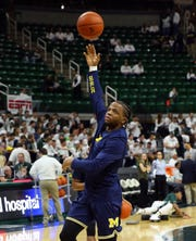 Michigan guard Zavier Simpson warms up prior to a game against Michigan State on Saturday, March 9, 2019, in East Lansing.