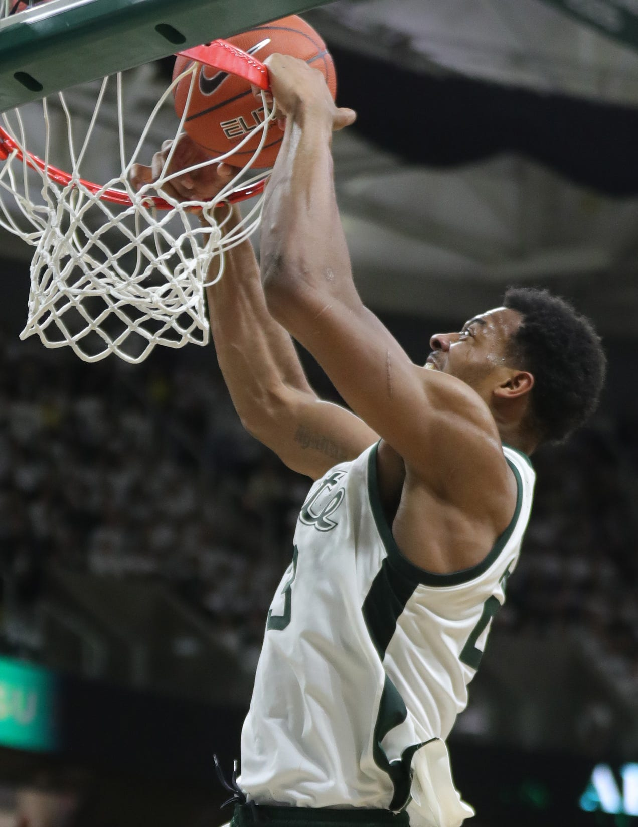 Michigan State forward Xavier Tillman scores against Michigan during second half action, Saturday, March 9, 2019 at the Breslin Center in East Lansing, Mich.