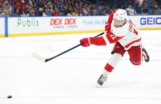 Red Wings right wing Filip Zadina shoots during the second period of the Wings' 3-2 loss on Saturday, March 9, 2019, in Tampa, Fla.