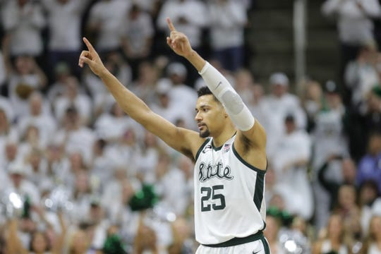 Michigan State senior Kenny Goins waves to fans as he leaves the court Saturday, March 9, 2019 at the Breslin Center in East Lansing, Mich.