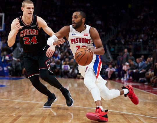 Pistons guard Wayne Ellington dribbles defended by Bulls forward Lauri Markkanen in the first half on Sunday, March 10, 2019, at Little Caesars Arena.