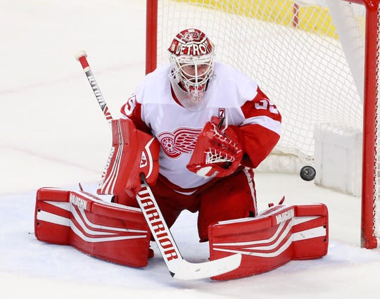 Red Wings goaltender Jimmy Howard blocks a shot during the second period on Sunday, March 10, 2019 in Sunrise, Fla.