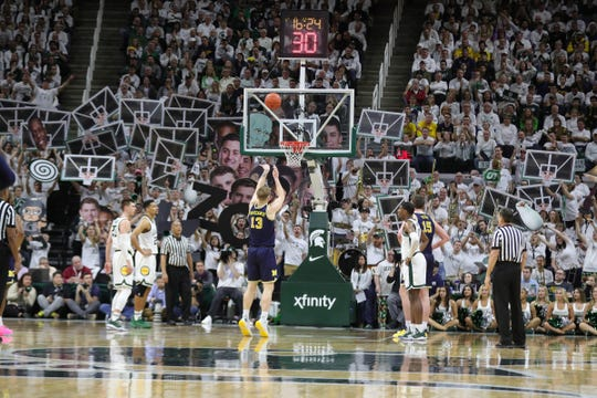 Michigan State fans try to rattle Michigan forward Ignas Brazdeikis as he shoot free throws during first half action Saturday, March 9, 2019 at the Breslin Center in East Lansing, Mich.