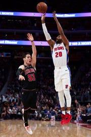 Pistons guard Wayne Ellington shoots on Bulls guard Ryan Arcidiacono in the first half on Sunday, March 10, 2019, at Little Caesars Arena.