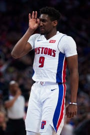 Pistons guard Langston Galloway celebrates a 3-point basket in the second half of the Pistons' 131-108 win on Sunday, March 10, 2019, at Little Caesars Arena.