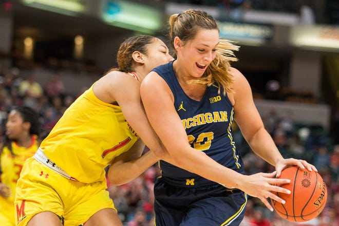 Michigan center Hallie Thome is fouled by Maryland forward Shakira Austin in the second half of U-M's 72-71 loss in the Big Ten women's tournament semifinal on Saturday, March 9, 2019, in Indianapolis.