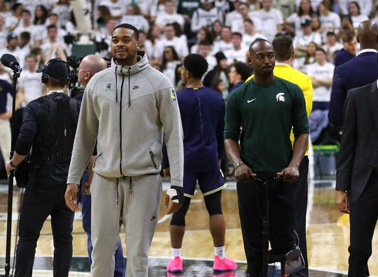 Nick Ward, left, and Joshua Langford look on prior to the game against Michigan at Breslin Center on March 9.