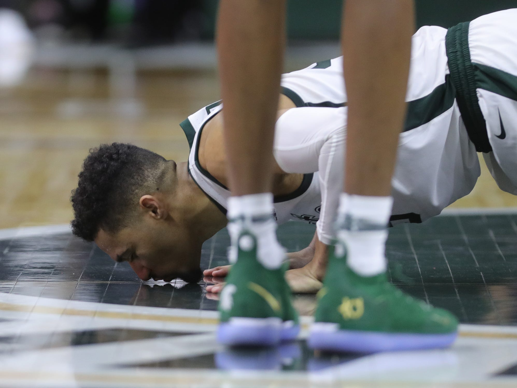 Michigan State senior Kenny Goins kisses the Spartan logo as he leaves the court, Saturday, March 9, 2019 at the Breslin Center in East Lansing, Mich.