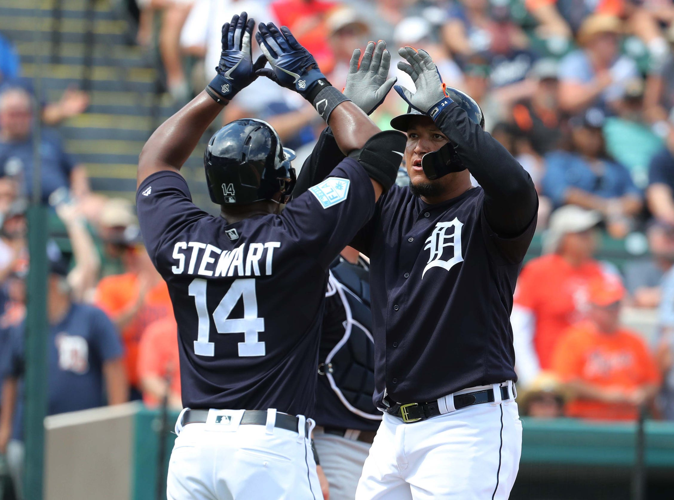 Tigers designated hitter Miguel Cabrera celebrates at home plate with left fielder Christin Stewart after his home run during the second inning in the exhibition tie against the New York Yankees on Sunday, March 10, 2019, at Joker Marchant Stadium.