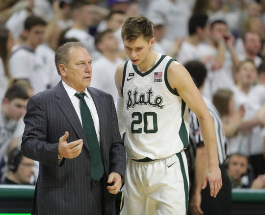 Michigan State head coach Tom Izzo talks to Matt McQuaid on the bench during second half action against Michigan Saturday, March 9, 2019 at the Breslin Center in East Lansing, Mich.