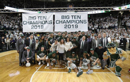 Michigan State players and coaches in front of the Big Ten Championship banner Saturday, March 9, 2019 at the Breslin Center in East Lansing, Mich.