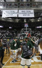 Michigan State guard Cassius Winston holds the Big Ten trophy Saturday, March 9, 2019 at the Breslin Center in East Lansing, Mich.