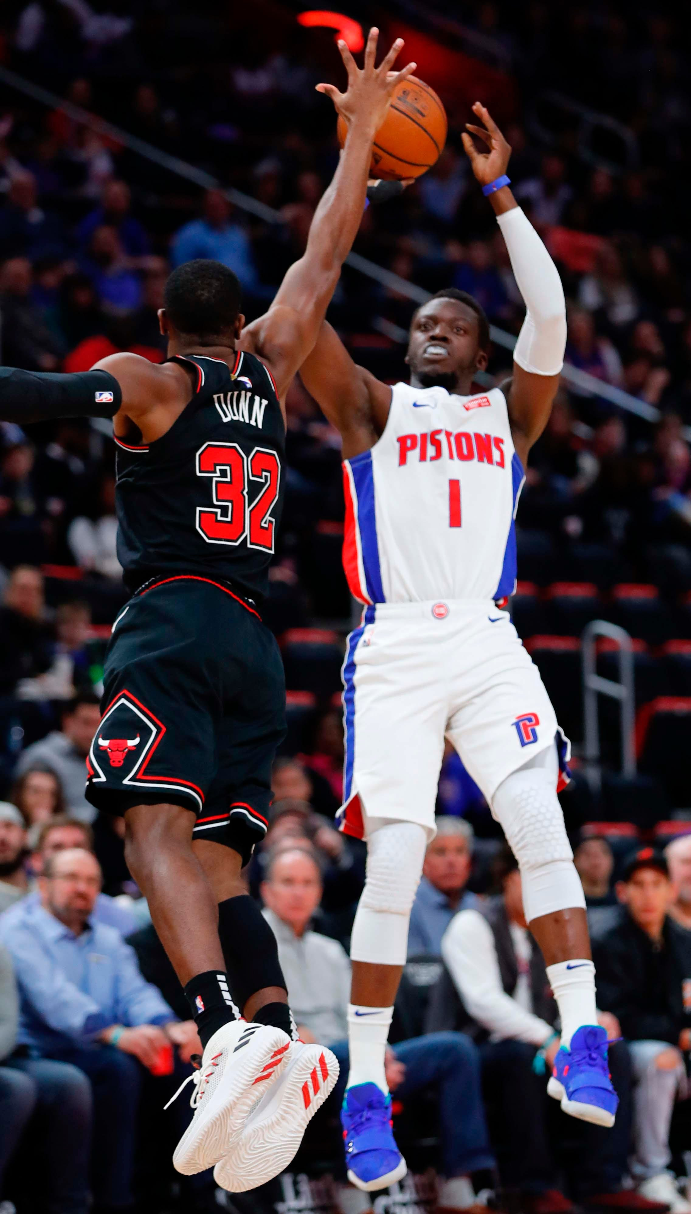 Pistons guard Reggie Jackson shoots on Bulls guard Kris Dunn in the first half on Sunday, March 10, 2019, at Little Caesars Arena.