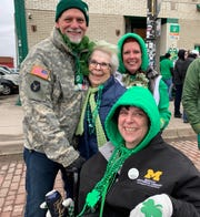 Family members (from left) Troy White, Pat Rensberger, Kathy White and (bottom) Mary Lou Rensberger of Livonia at the St. Patrick's Day Parade in Corktown on Sunday.