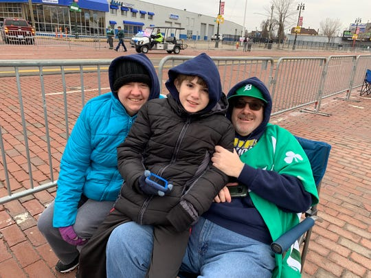 From left, Jennifer, Devin and Ray Bilyk of Southgate at the Corktown St. Patrick's Day Parade on Sunday.