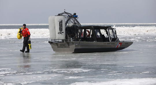 Emergency personnel prepare to rescue stranded fishermen off Catawba Island State Park, Ohio in Lake Erie, on Saturday, March 9, 2019.