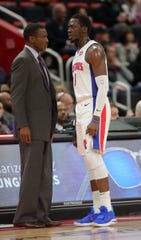 Pistons coach Dwane Casey talks to Reggie Jackson during the Pistons' 131-108 win on Sunday, March 10, 2019 at Little Caesars Arena.
