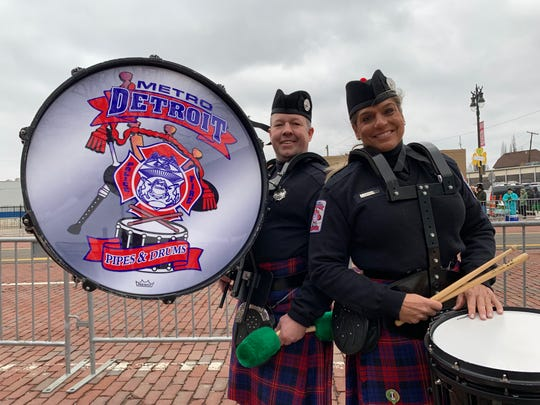 Stacy Swanderski, 48, a retired Farmington Hills police officer, and Rick Mattot, 39, of the Troy Fire Department, at the Corktown St. Patrick's Day Parade on Sunday. Both are a part of the Metro Detroit Police and Fire Pipes & Drums Band
