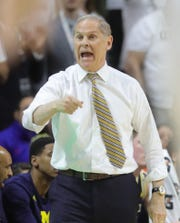 Michigan head coach John Beilein reacts to a play during first half action against Michigan State, Saturday, March 9, 2019 at the Breslin Center in East Lansing, Mich.