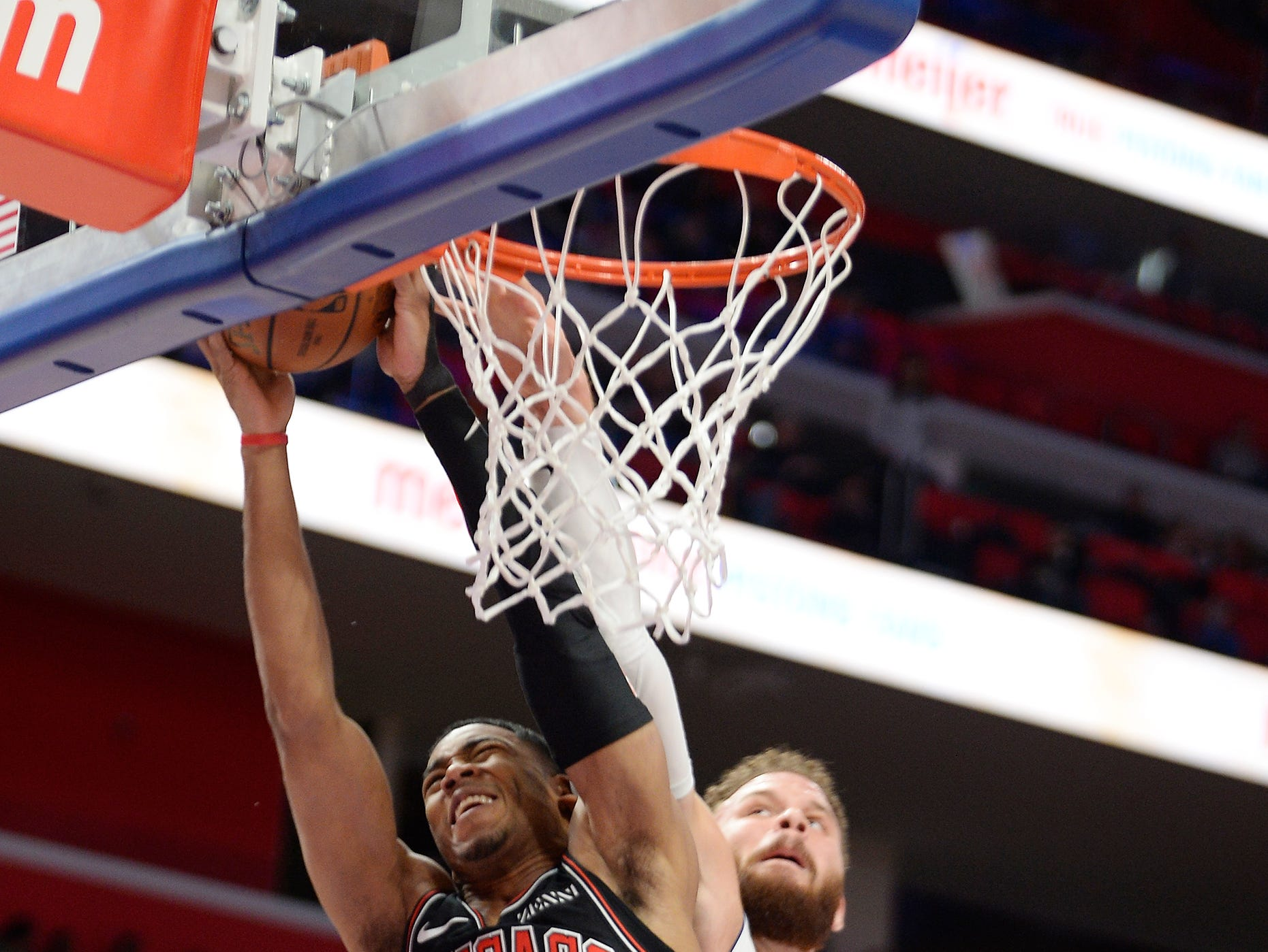 Pistons' Blake Griffin fouls Bulls' Shaquille Harrison in the first quarter.
