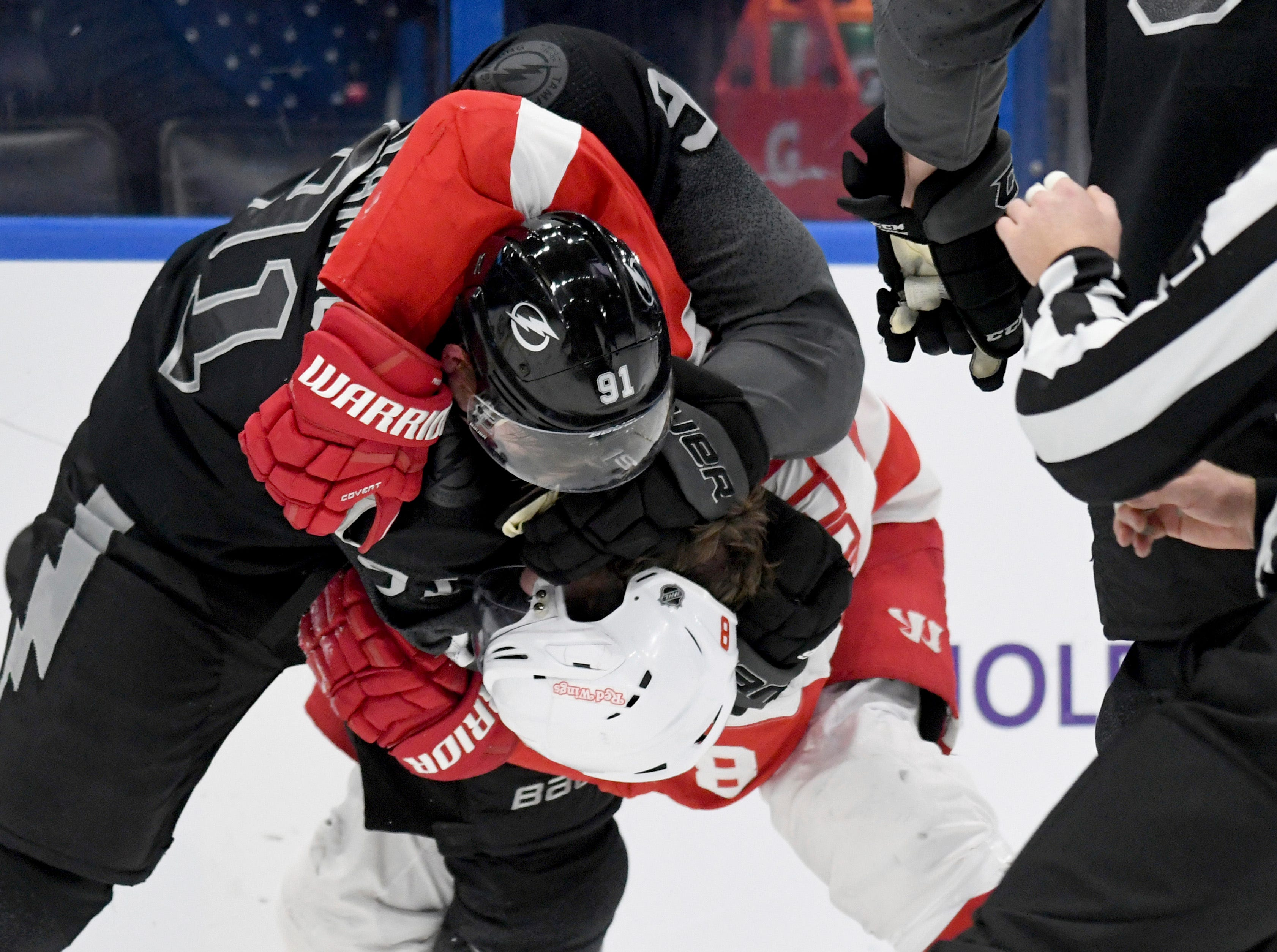 Tampa Bay Lightning center Steven Stamkos (91) and Detroit Red Wings left wing Justin Abdelkader (8) fight during the first period of an NHL hockey game Saturday, March 9, 2019, in Tampa, Fla. (AP Photo/Jason Behnken)