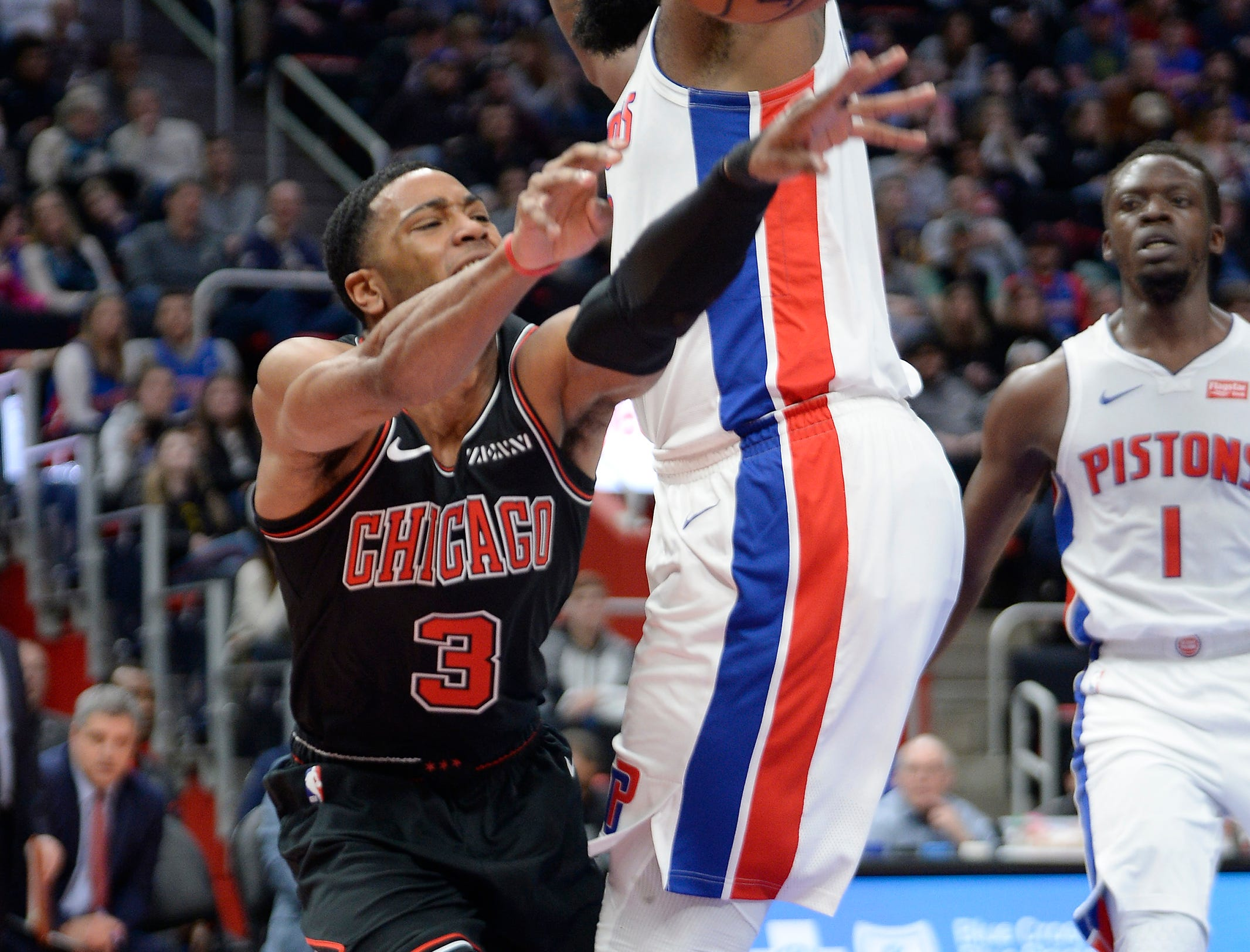 Pistons' Andre Drummond blocks the path of Bulls' Shaquille Harrison in the second quarter.
