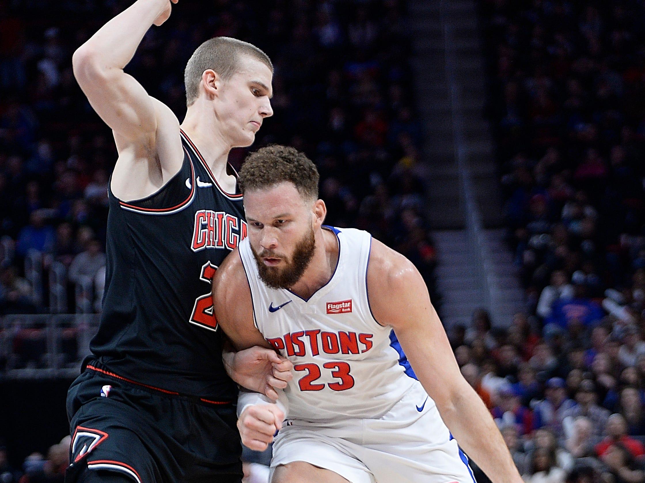 Pistons' Blake Griffin drives around Bulls' Lauri Markkanen in the third quarter.