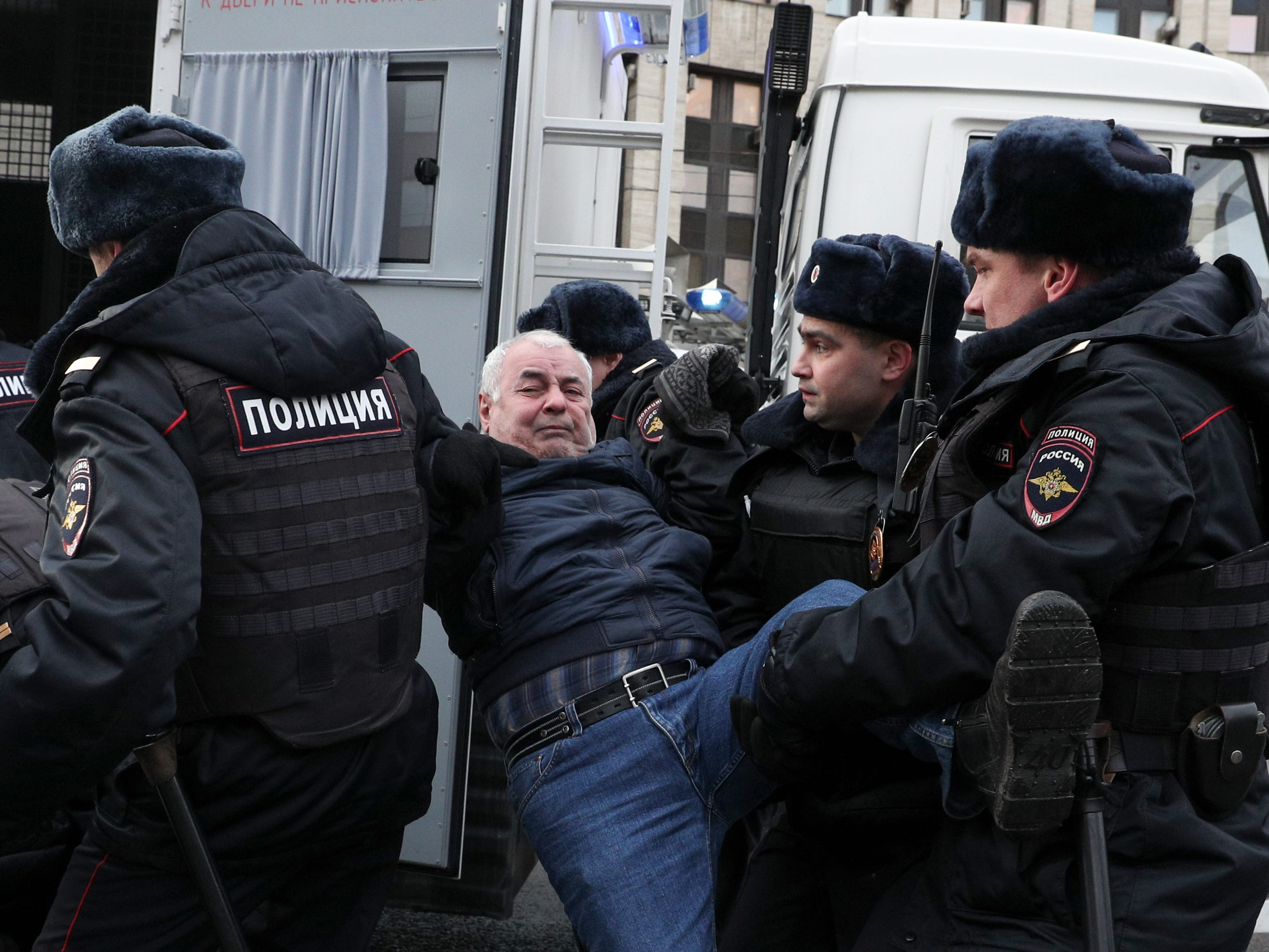 Police officers detain a demonstrator after the Free Internet rally in response to a bill making its way through parliament calling for all internet traffic to be routed through servers in Russia and making VPNs (virtual private networks) ineffective, in Moscow, Russia, Sunday, March 10, 2019. Several thousand people have rallied in Moscow to protest legislation that they fear could lead to widespread censorship of the internet.